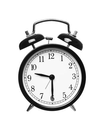 Alarm clock shows half past nine isolated on white background