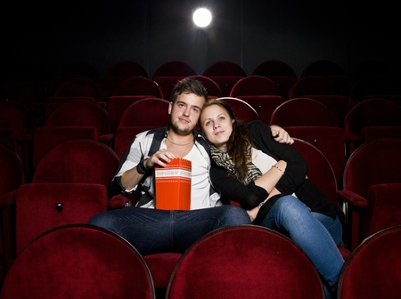Young couple alone at the Movie Theater