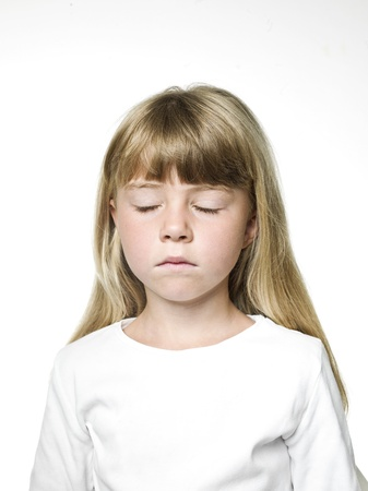 Photo pour Portrait of a Little Girl with her eys closed - image libre de droit