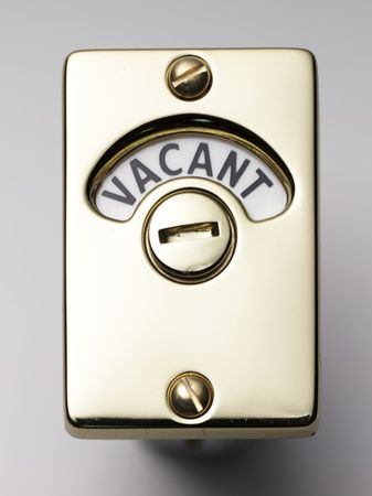 a face on view of a door lock saying vacant