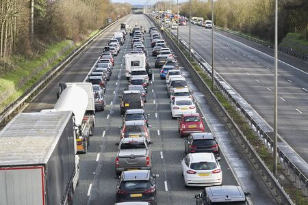 Photo for Emergency services closing motorway to attend accident causing a traffic jam - Royalty Free Image
