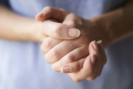 Foto de Close Up of a Woman rubbing her hands together with disinfectant  - Imagen libre de derechos