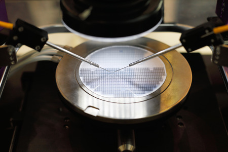 Semiconductor silicon wafer undergoing probe testing. Selective focus.