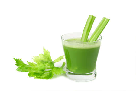 A glass of fresh celery juice  isolated on white background.