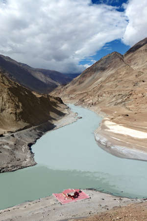 Confluence of rivers Zanskar and Indus in Himalayan mountains, Ladakh, Jammu and Kashmir. India