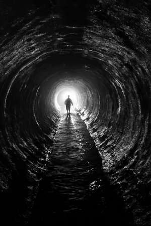 Foto de silhouette in a  communication tunnel  Light at End of Tunnel  - Imagen libre de derechos