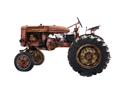 Foto de Rustic old red tractor, isolated on white background. Agriculture concept - Imagen libre de derechos