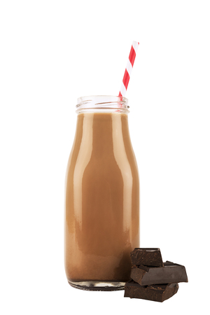 Photo for Vintage chocolate milk bottle isolated on white background. Drinking straw and chocolate squares in decoration. - Royalty Free Image