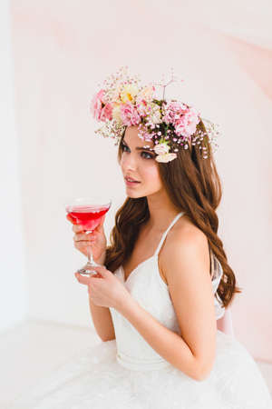 Photo for Cose-up portrait of beautiful bride with flower wreath on her head and glass - Royalty Free Image