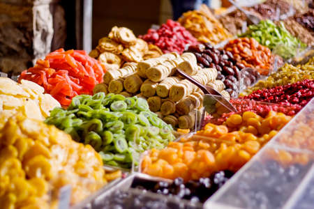 Colorful healthy dried fruits in the market, focus on figs