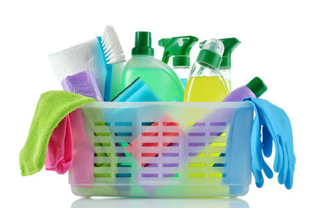 Cleaning products and supplies in a basket  Cleaners, microfiber cloths, gloves  in a basket isolated on white background  Cleaning kit