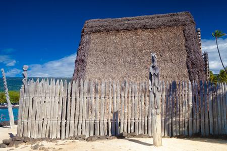 Hawaiian thatched roof dwellings at ancient Hawaiian site Pu'uhonua O Honaunau National Historical Park on Big Island, Hawaii