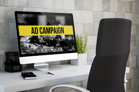 3d rendering of industrial workspace showing ad campaign on computer screen. All screen graphics are made up.
