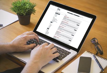 Photo pour job search online concept. Close-up top view of a job hunter working on laptop. - image libre de droit