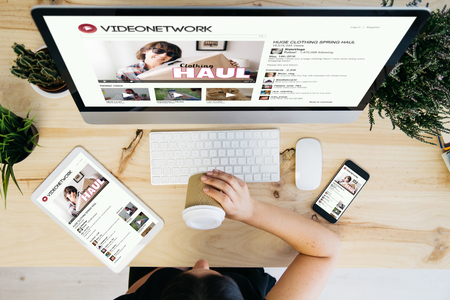 Photo for overhead view of woman drinking coffee and browsing video network - Royalty Free Image