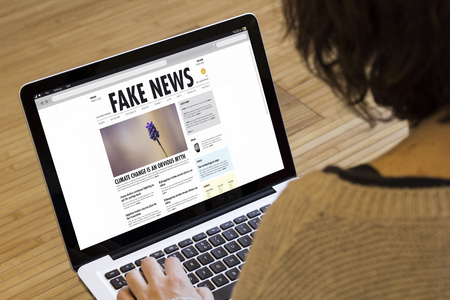 Photo pour fake news concept on a laptop screen. Screen graphics are made up. - image libre de droit