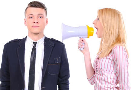 Portrait of angry woman shouting at his boyfriend through megaphone who is indifferent to it
