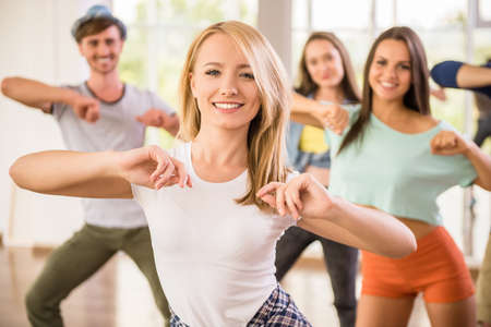 Photo for Young dancing people in gym during exercise dancer workout training with happy fresh energy. - Royalty Free Image