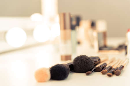 Photo pour Close-up of makeup brushes lying on table in stylist room - image libre de droit