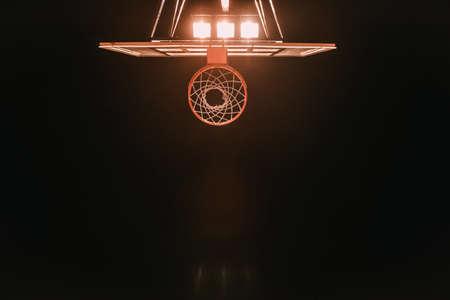 Foto de Bottom view of basketball hoop on night sky background, lights are turned on - Imagen libre de derechos
