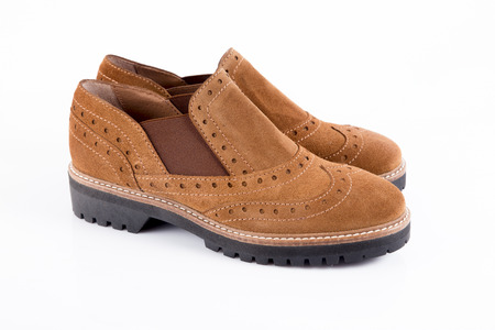 Foto de Female brown leather shoe on white background, comfortable footwear - Imagen libre de derechos
