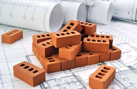Foto de Bricks for building a house with design drawings - Imagen libre de derechos