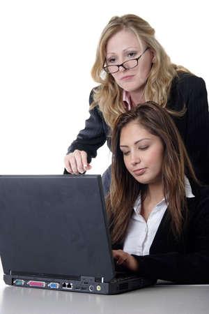 Boss looking over secretary's shoulder