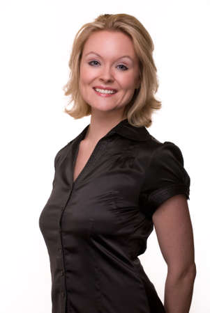 Portrait of an attractive woman with blond hair and blue eyes with nice smile facial expression wearing black satin blouse over white