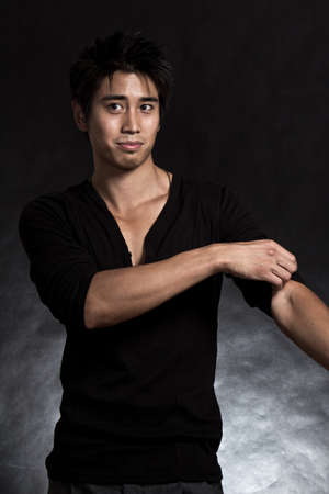 Handsome asian american fashionable man in black