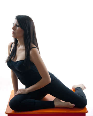 Attractive twenties hispanic woman doing yoga exercise