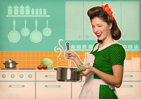Young housewife cooking soup in her kitchen room.Retro style poster on old paperの写真素材