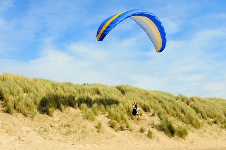 Para pretty above the dunes near the beach
