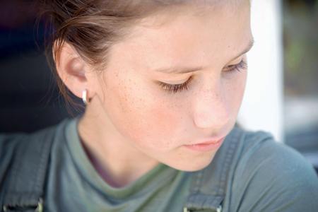 sorrow school girl looking away