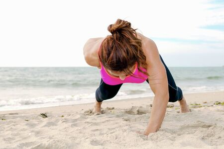 fitness girl excercise and workout on the beach