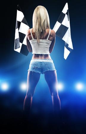 Photo pour Sexy blonde woman starts racing - image libre de droit