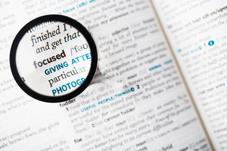 Dictionary definition of the word focused and reading glass