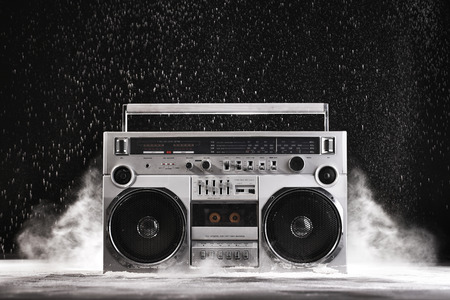 1980s Silver Retro ghetto blaster and dust isolated on black background