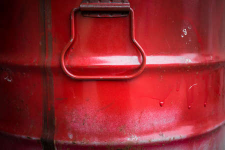 Extreme close up of a red barrel of oil.