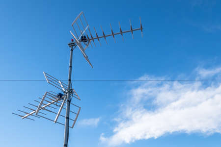 Photo for Television antenna against blue sky - Royalty Free Image