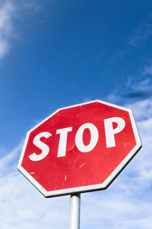 Photo pour Stop sign against blue sky and white clouds. Bottom  view. Space for text. - image libre de droit