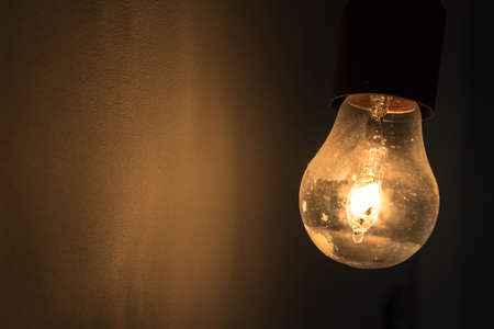Photo for Old vintage light bulb glowing in the dark. Ideal for concepts. - Royalty Free Image