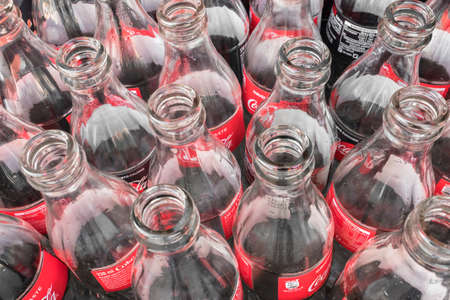 Photo pour Empty glass bottles of Coca Cola, close-up. View from above. Italy February 19 2019. - image libre de droit