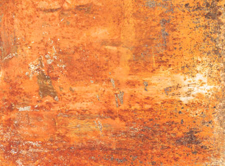 Foto de Rusty textured metal background. Grunge orange panel with oxidized or rusty marks produce a colorful painted surface that is full of texture and patterns. - Imagen libre de derechos