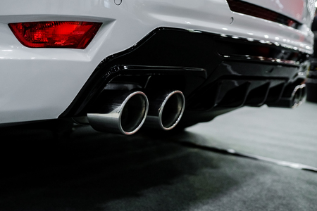 Photo for Close up of tuning white car exhaust pipe. - Royalty Free Image