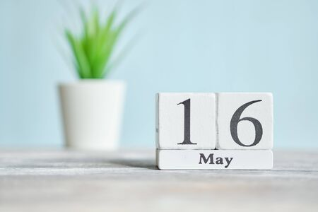 16 sixteenth day May Month Calendar Concept on Wooden Blocks. Close up.