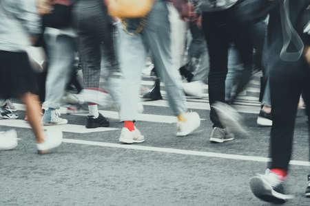 Photo pour Blurred pedestrian traffic on the street of a European city. - image libre de droit