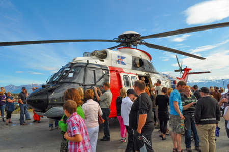 Dalvik Iceland - August 7. 2010: People looking at Icelandic coastguard helicopter TF-LIF