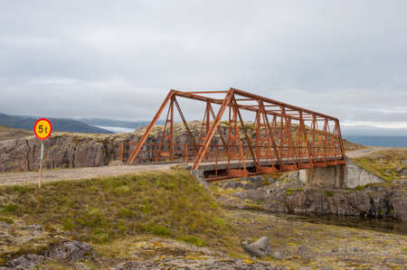 old Bridge over Heinabergsfljot river in Iceland. due to glacier melting the river has changed route so the bridge does not have any function today