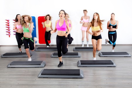 image of group of women in a steps class at the gym