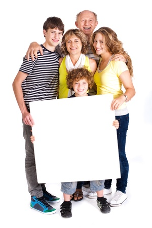 Photo for Portrait of a happy family holding a billboard isolated over white background.. - Royalty Free Image